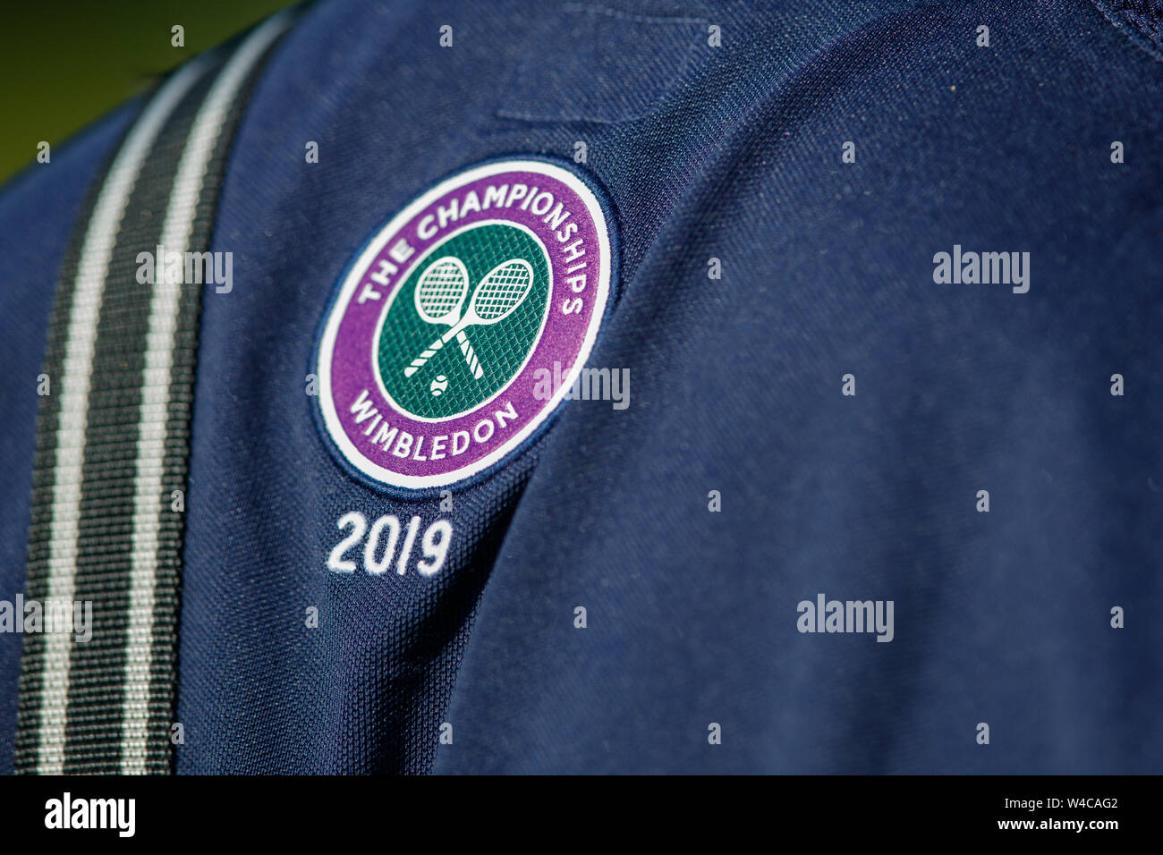 50f47540 Detail of Wimbledon Logo on a Ball Boy's shirt. The Championships 2019.  Held at