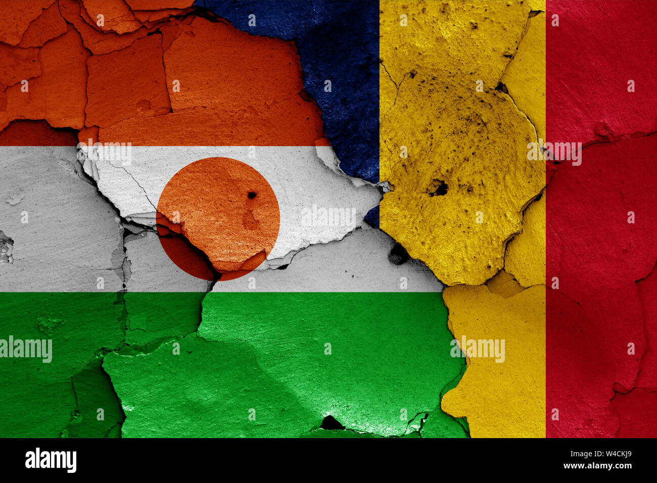 flags of Niger and Chad painted on cracked wall Stock Photo