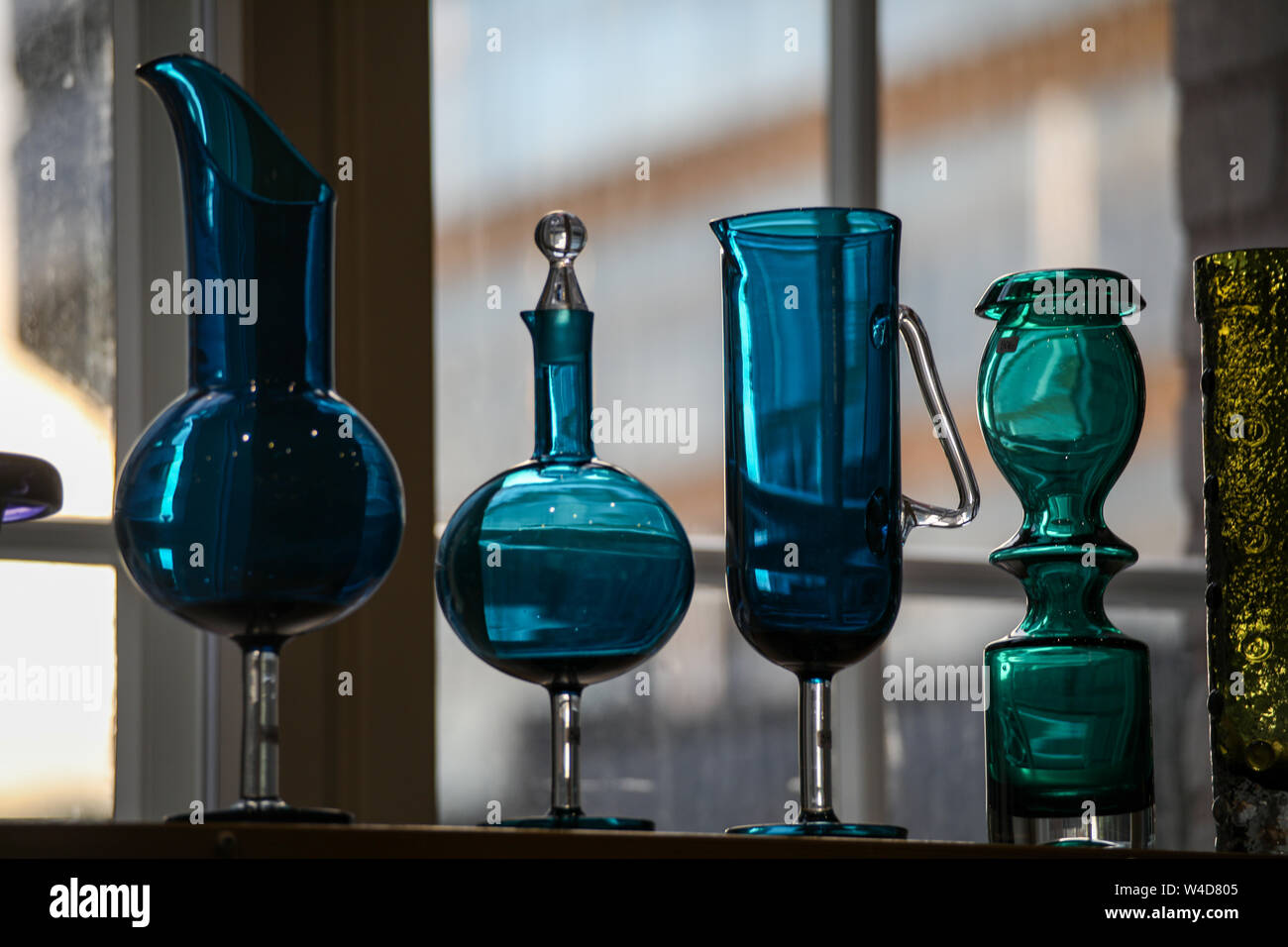 Blue glass ewers and green glass vases at Retro and Vintage Design Expo in Helsinki, Finland Stock Photo