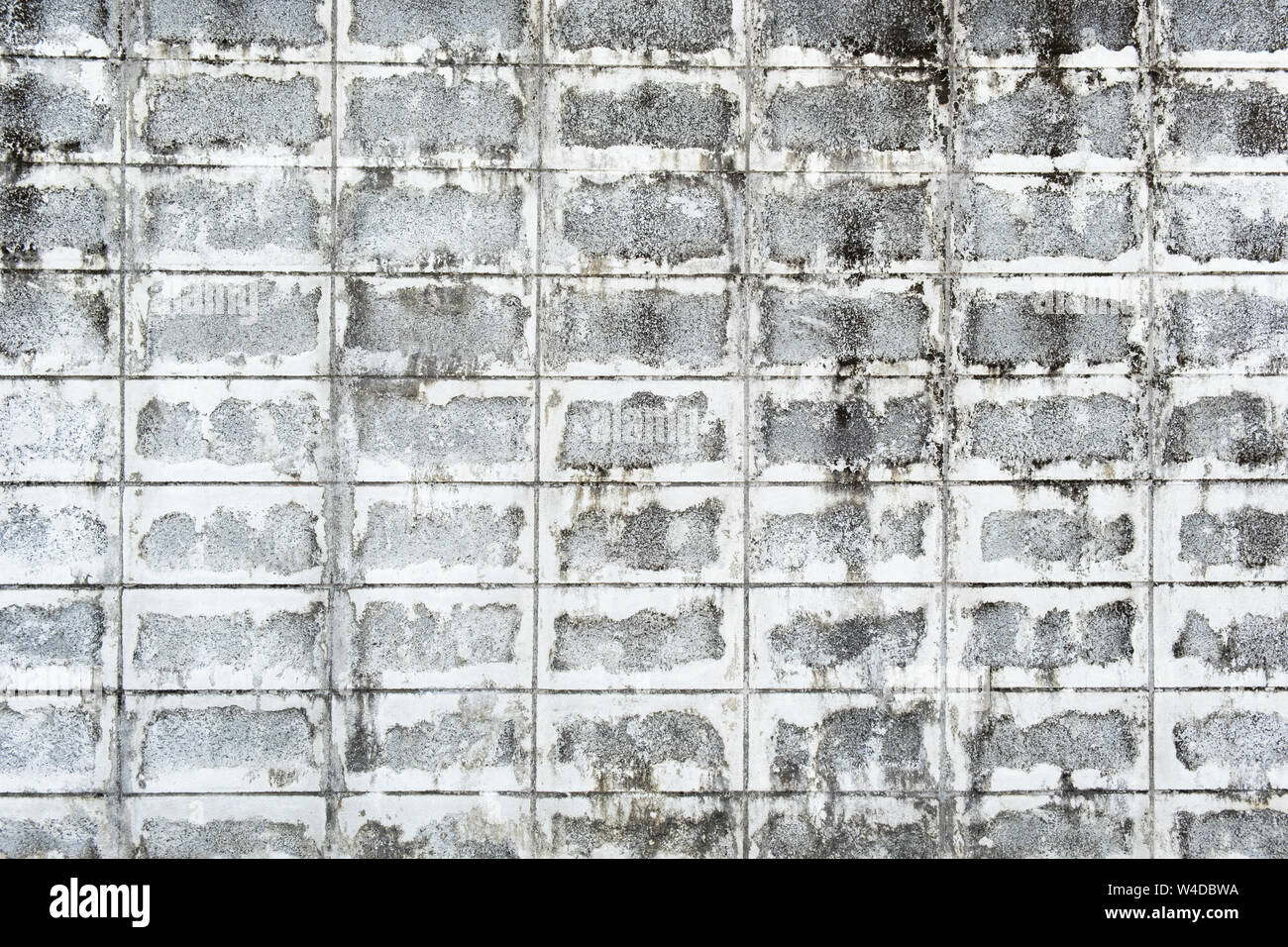 Urban background, white ruined industrial concrete brick wall . Stock Photo