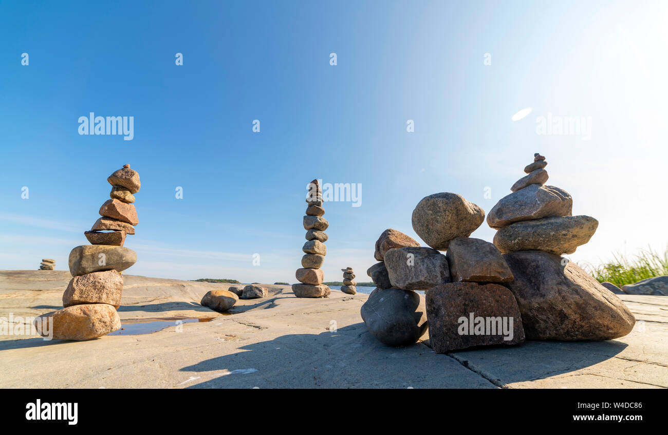 Stacked Rocks balancing, stacking with precision. Stone tower on the shore. Copy space. Stock Photo