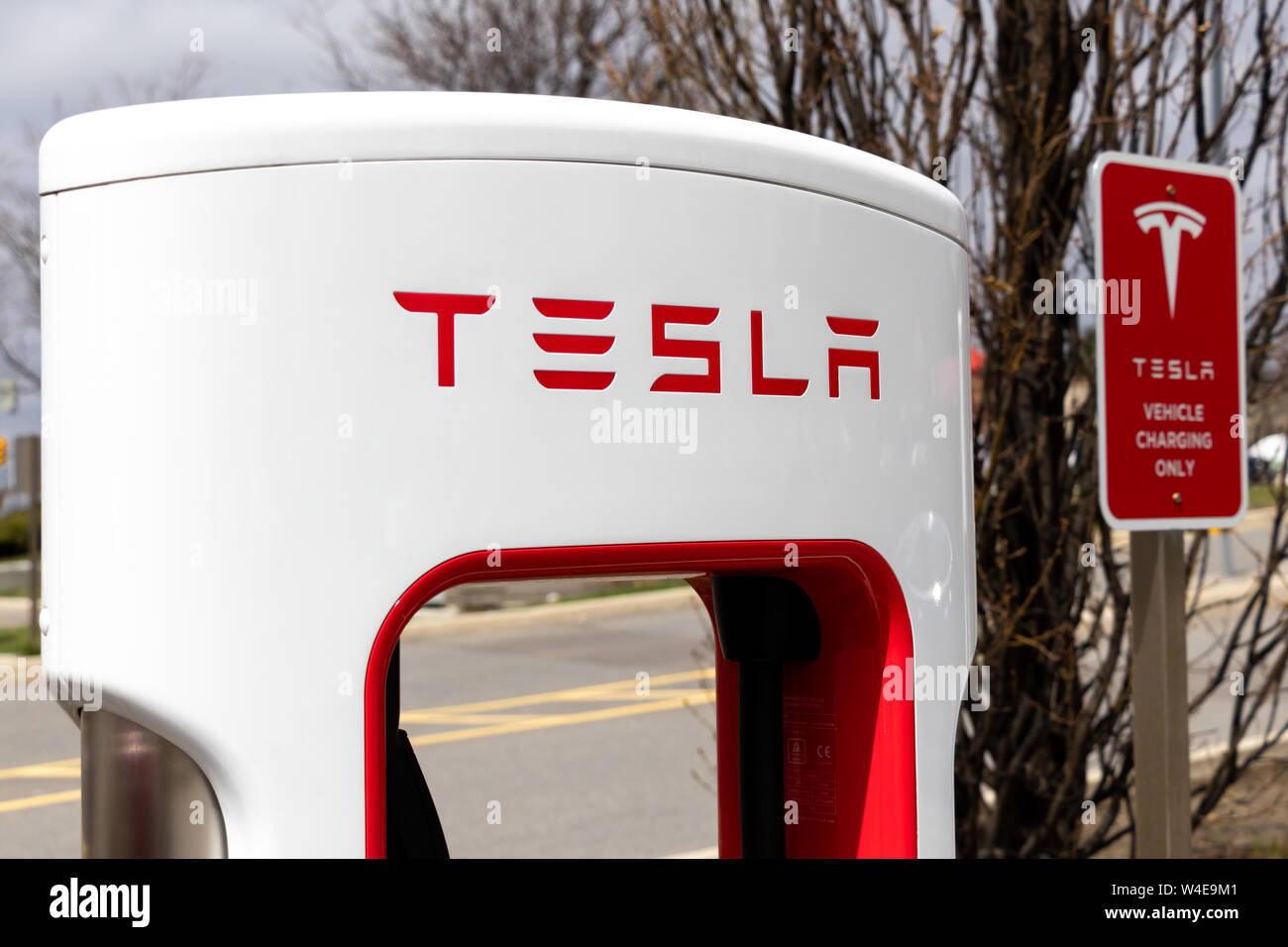 Tesla Supercharger and Tesla Vehicle Charging Only Sign at