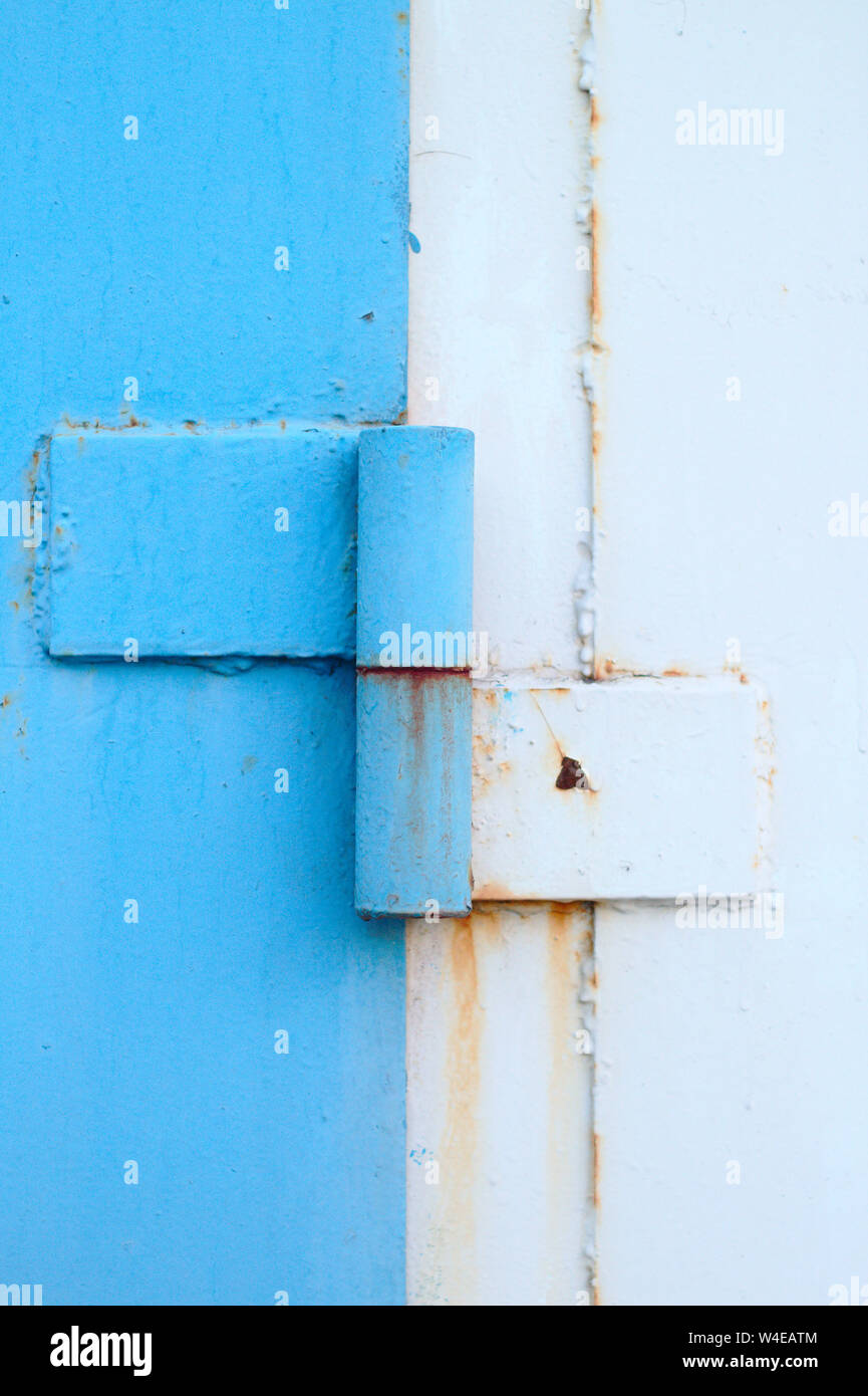 abstract image of an old blue white metal door canopy Stock