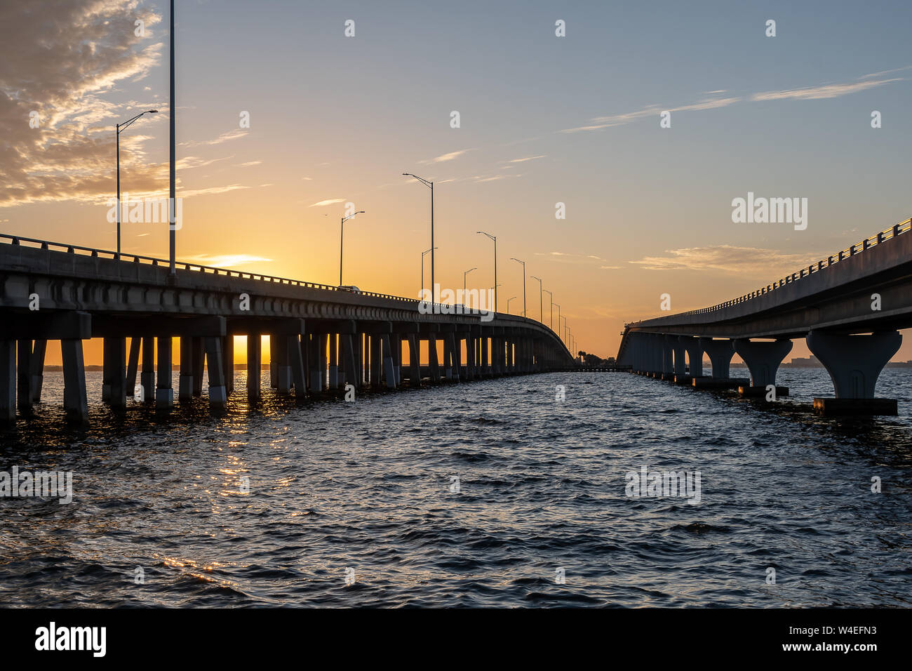 View between two bridges  as the sun rises Stock Photo