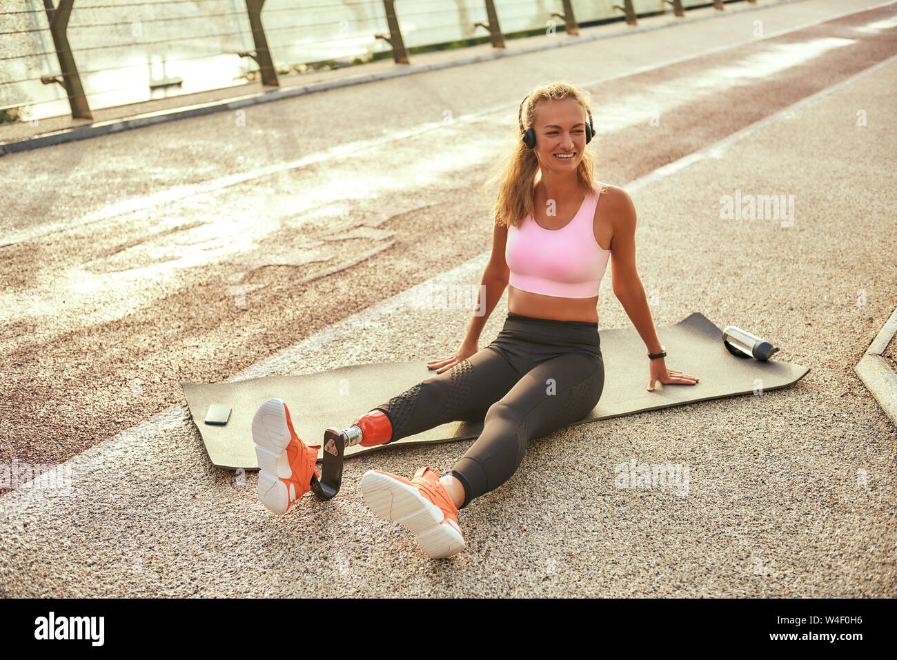 Woman Headphones Running In Stadium Stock Photos & Woman