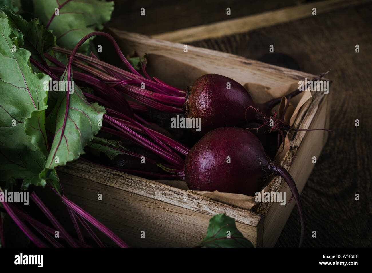 Fresh homegrown beetroots on wooden rustic table,  plant based food, local produce, close up Stock Photo