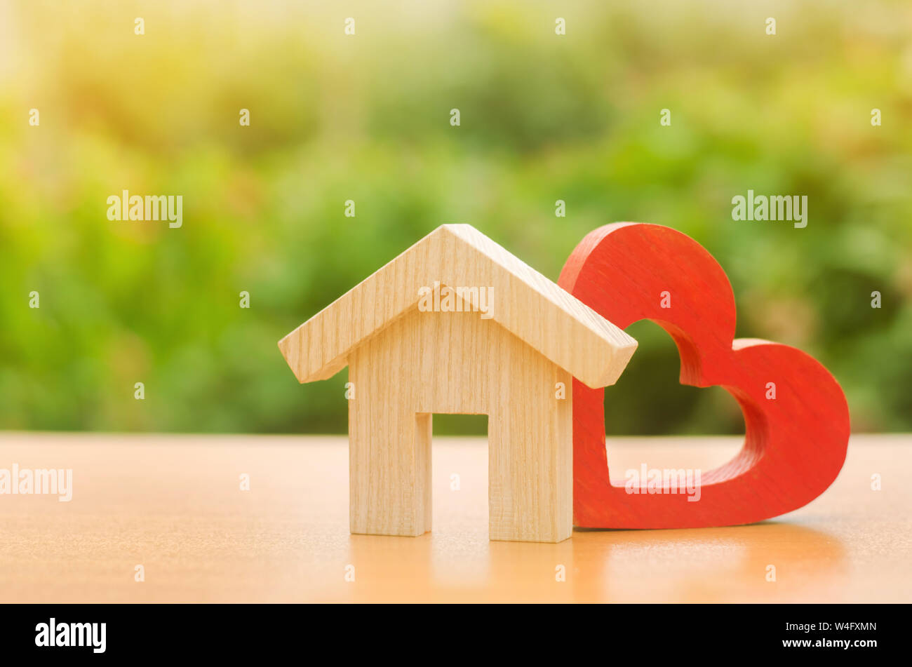 House with a red wooden heart. House of lovers. Parental hospitable home. Housing construction of your dreams. Buying and renting real estate. Afforda Stock Photo