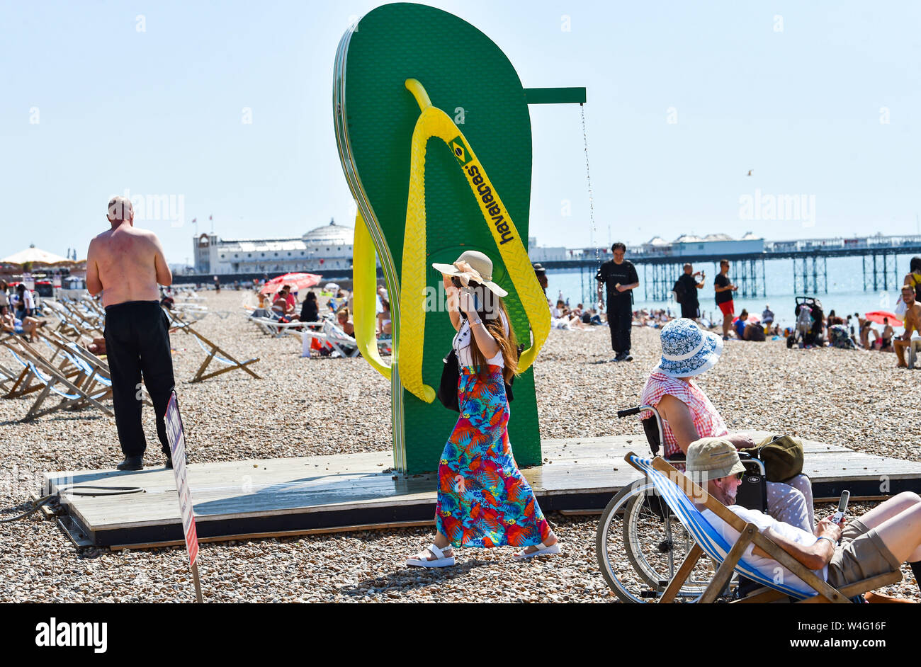 Brighton UK 23rd July 2019 - Sunseekers flock to Brighton Beach which is bathed in glorious hot sunshine today . Heatwave conditions are forecast for the South East of Britain with temperatures expected to reach the mid thirties today and over the next few days . Credit: Simon Dack / Alamy Live News Stock Photo
