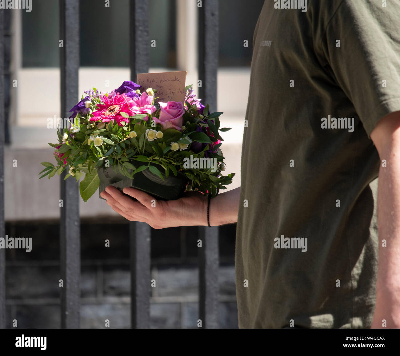 Downing Street, London, UK. 23rd July 2019. Flowers are delivered to The Right Honourable Theresa May in Downing Street during her final Cabinet Meeting before she resigns. Credit: Malcolm Park/Alamy Live News. Stock Photo