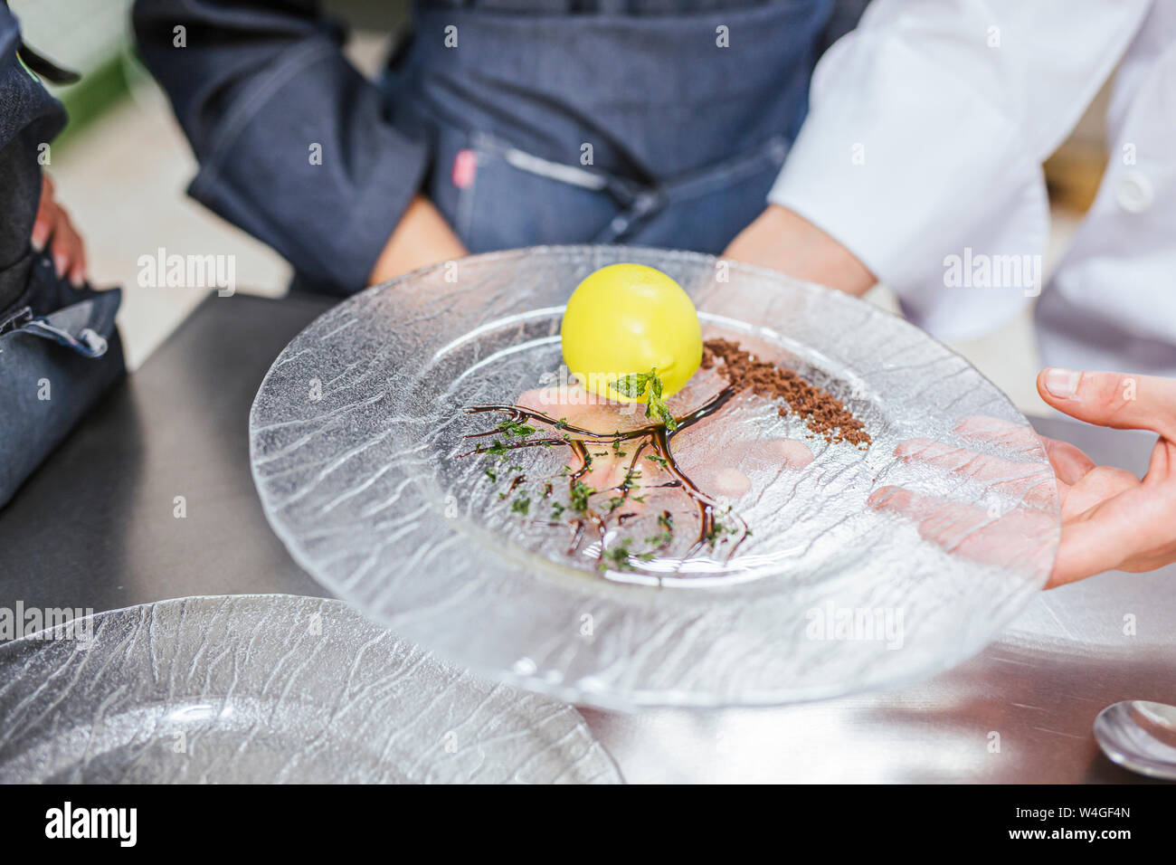 Junior chef showing his prepaired dessert on plate Stock Photo
