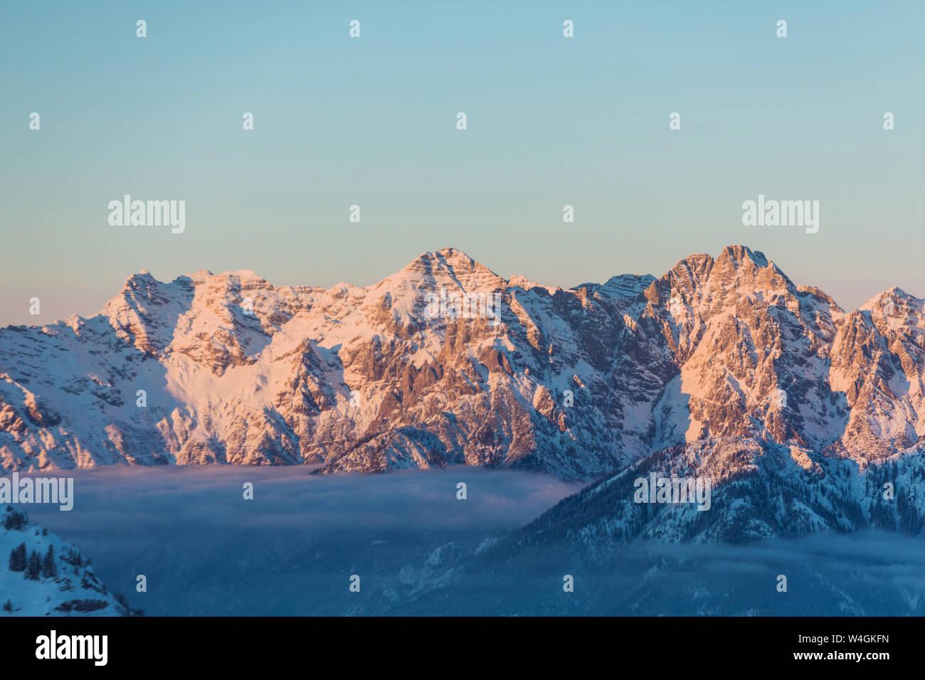 View over snowy mountains at dusk, Saalbach Hinterglemm, Pinzgau, Austria Stock Photo