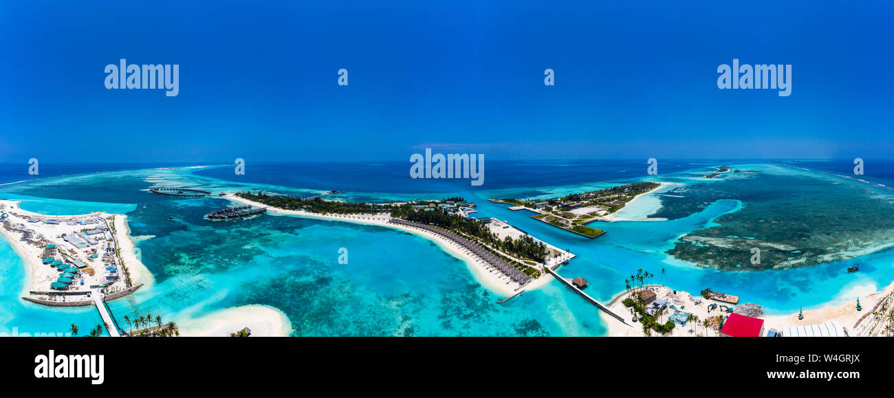 Aerial View Over Olhuveli And Bodufinolhu With Fun Island