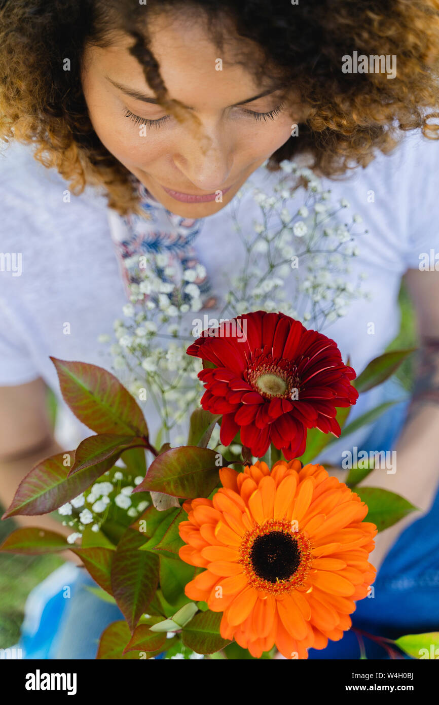 Close-up of woman holding flowers outdoors Stock Photo