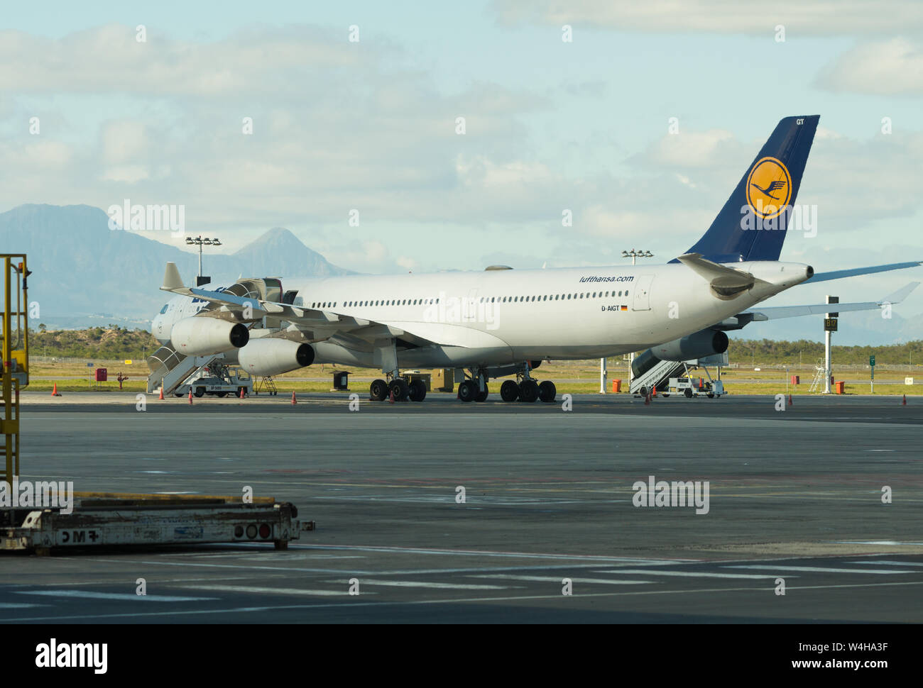 Lufthansa German Airlines commercial airliner and airplane parked on the tarmac at Cape Town International airport, South Africa Stock Photo