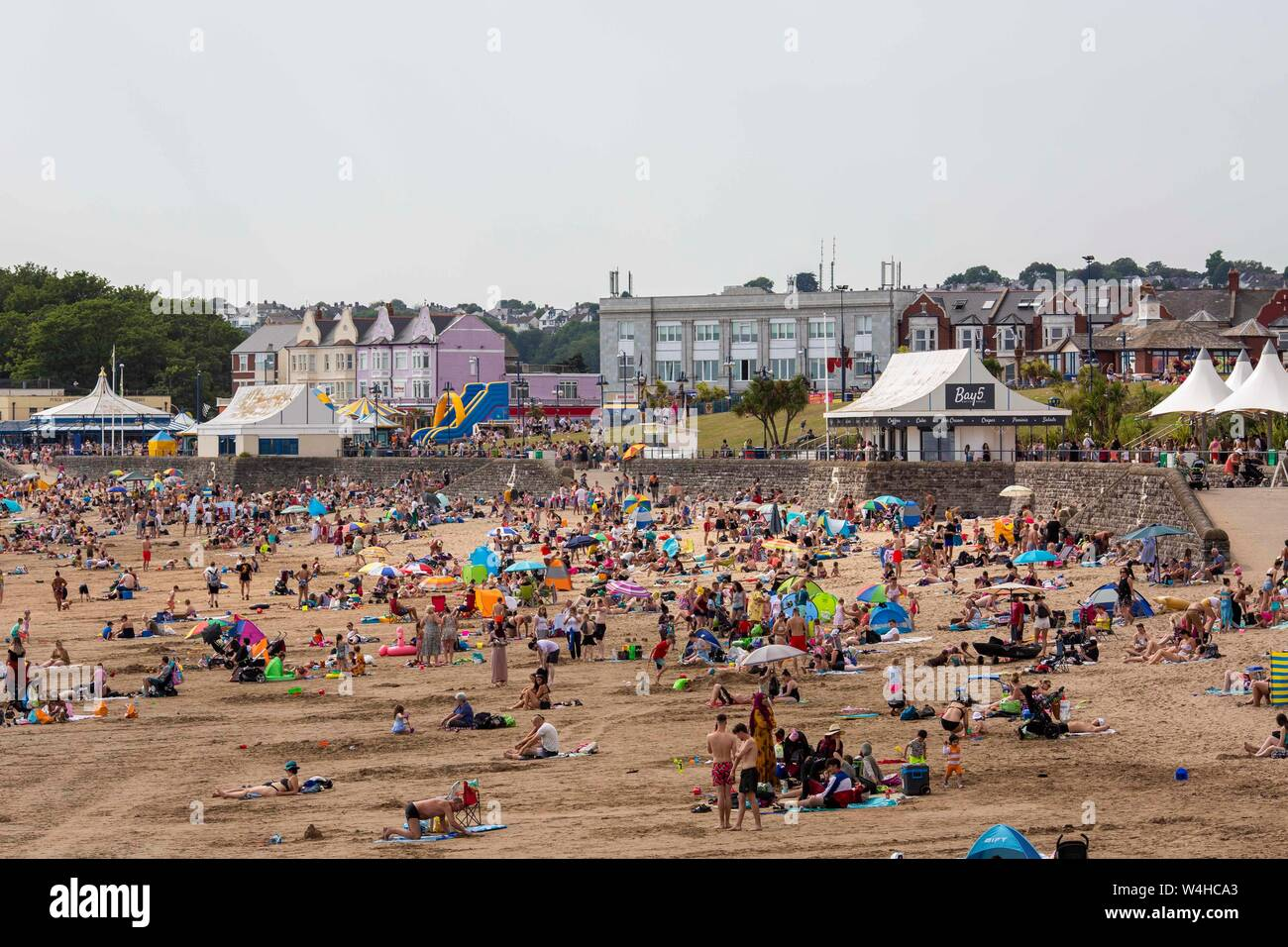 Barry, Wales, Uk. 23rd July, 2019. Barry, Wales, UK. July 23rd 2019. Revellers enjoy the heatwave at Barry Island beach. Credit: Mark Hawkins/Alamy Live News Stock Photo