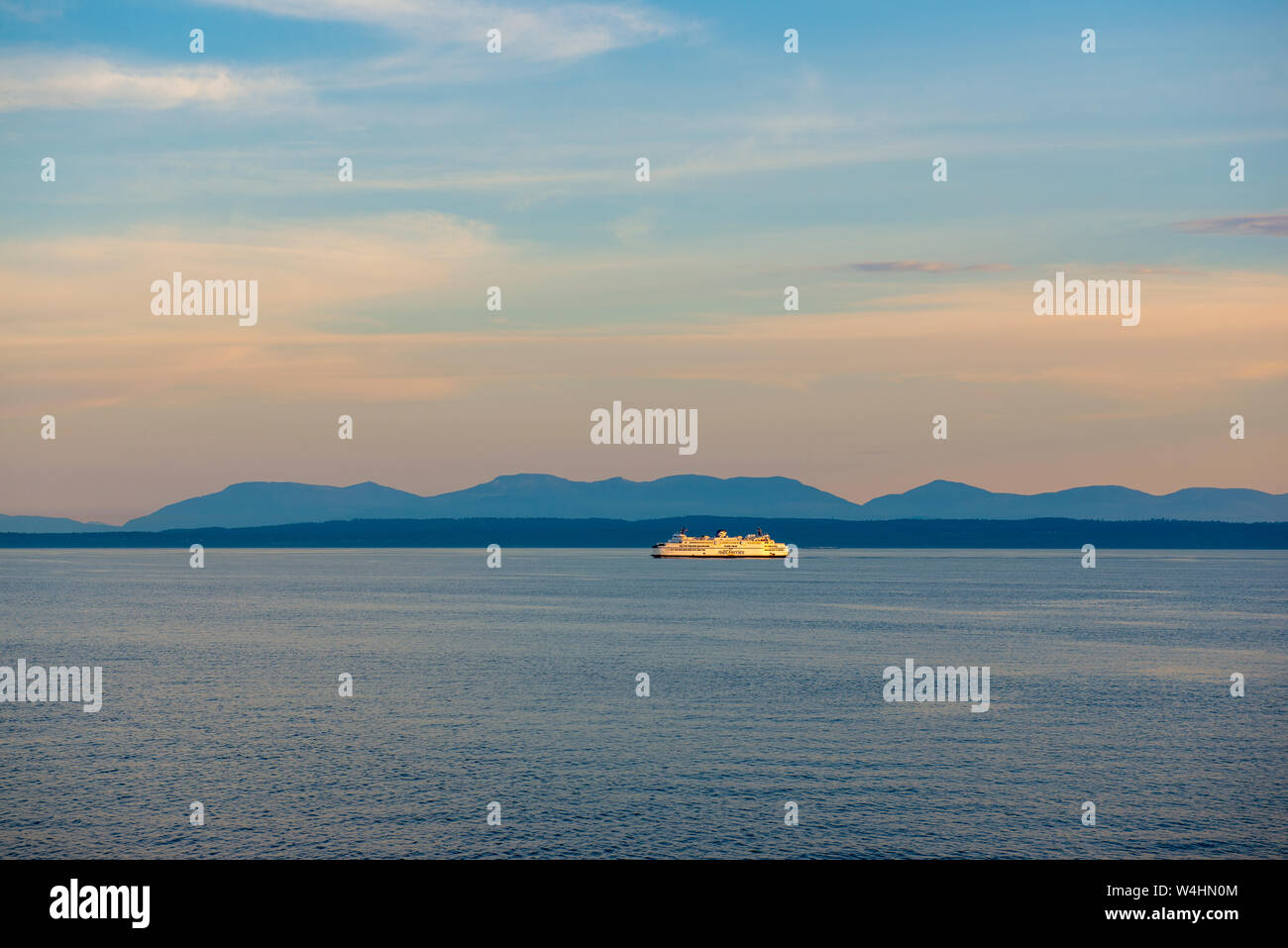 NANAIMO, BC - JUNE 19, 2018: A BC ferry sailing at sunset in Nanaimo. BC ferries provides all major ferry services for coastal and island communities Stock Photo