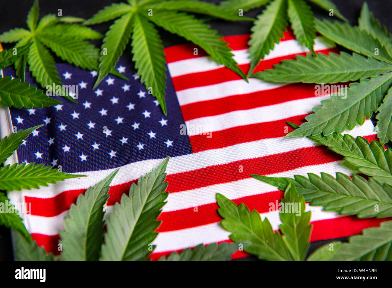 Cannabis leaves framing the american flag with copyspace - veteran theme medical marijuana concept Stock Photo