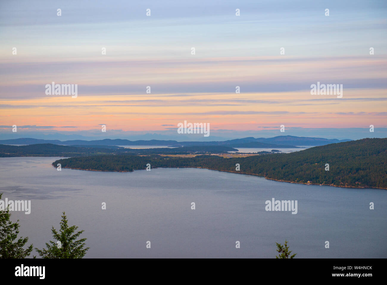 View of the Saanich inlet and gulf islands from the Malahat summit at sunset in Vancouver Island, BC, Canada Stock Photo