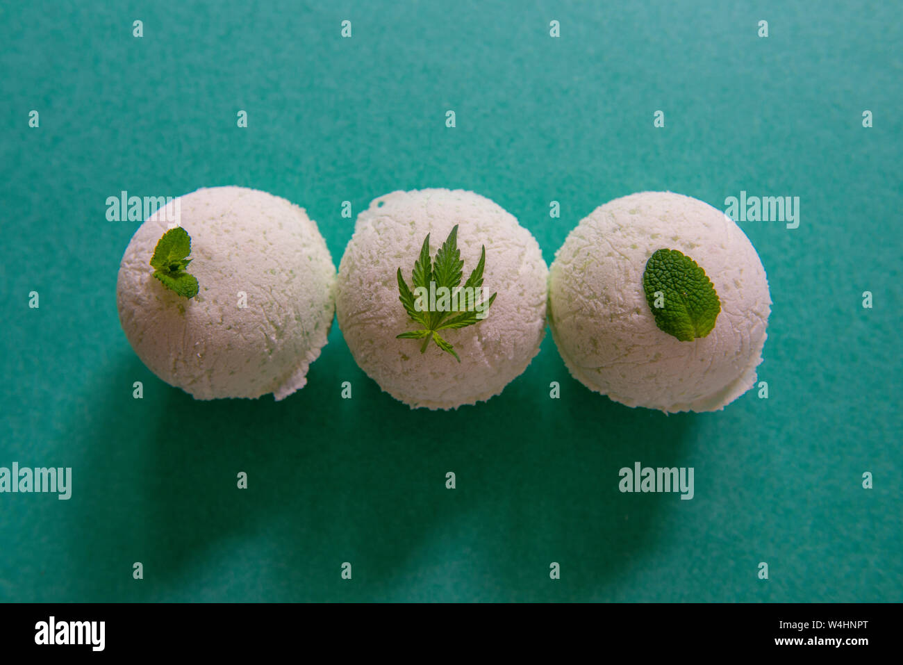Cannabis wellness background with bath bombs, mint and marijuana leaf - cannabis spa concept Stock Photo