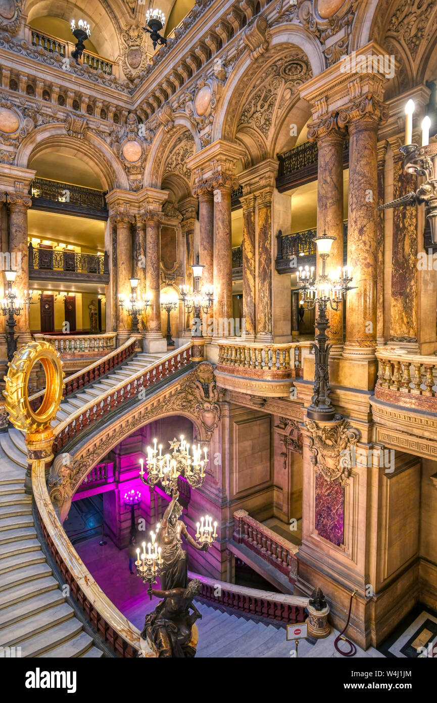 Paris, France - April 23, 2019 - The Grand Staircase at the ... on houses with dual staircases, indoor staircases, house plans with 2 staircases, plans for staircases, types of staircases, mansion double grand staircases, luxury staircases, contemporary staircases, victorian staircases, windows for staircases, beautiful staircases, house plans of 1930 cottages, interior staircases, rustic grand staircases, house plans with grand entrances, open foyers with staircases, houses with double staircases, traditional staircases, old house staircases, hotels with grand staircases,
