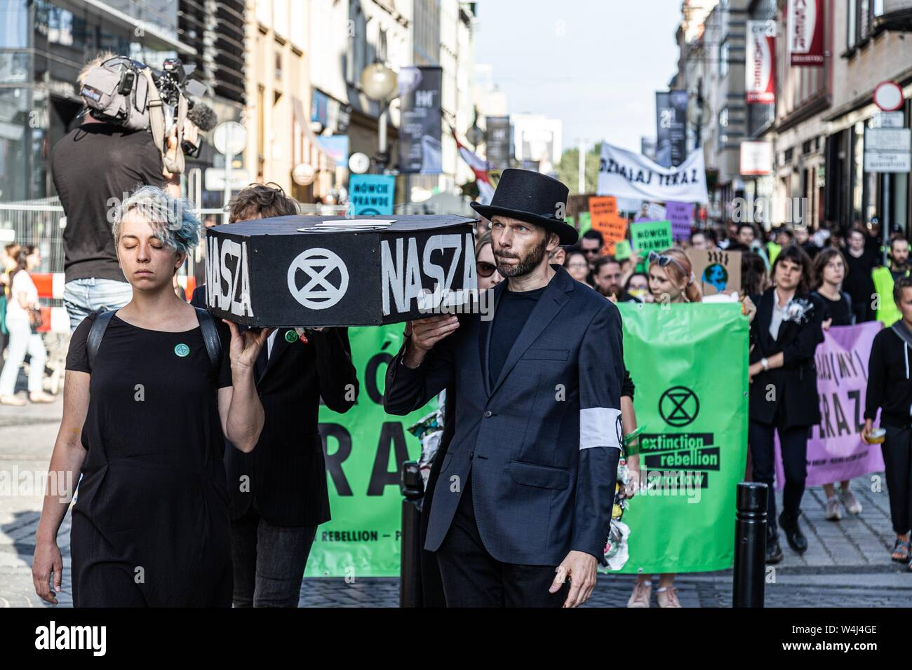 Wroclaw, Poland. 23rd July, 2019. 23 July 2019 Wroclaw Poland. Extinction Rebellion in Wroclaw. The funeral procession of the future and the past passed through the city in a protest against climate change. Credit: Krzysztof Kaniewski/ZUMA Wire/Alamy Live News Stock Photo