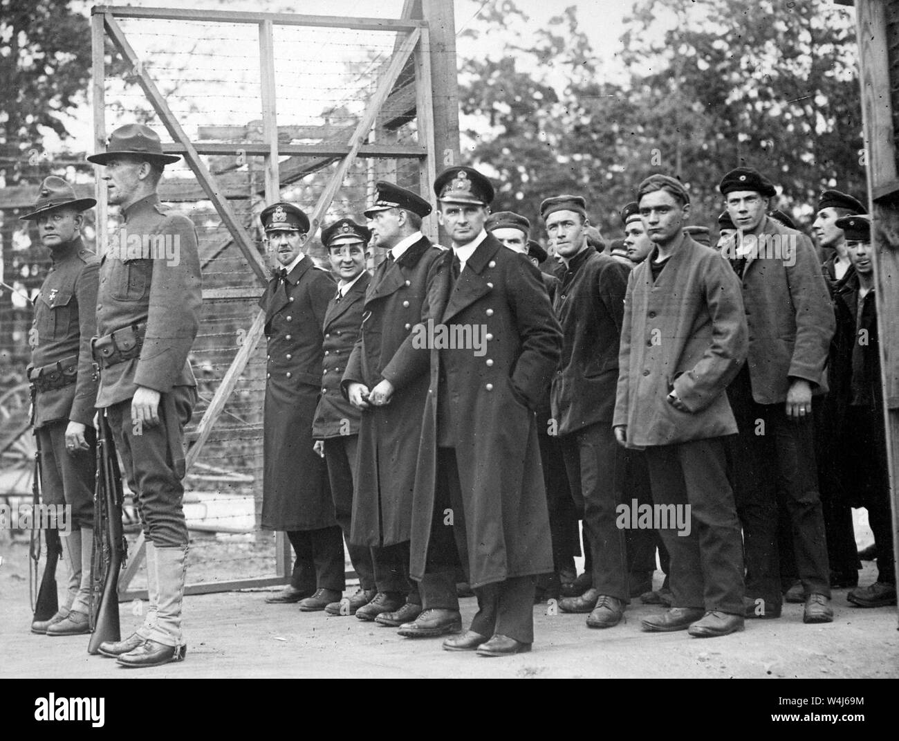 Officers and crew of the German submarine U.58, captured by the U.S.S. Fanning, entering the War Prison Camp at Fort McPherson, Georgia, USA. 1918 Stock Photo