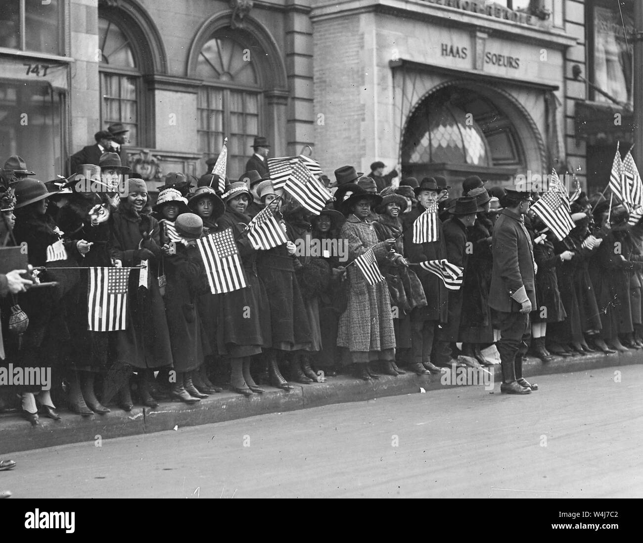 Crowds waiting for the parade of the famous 369th African American Infantry, formerly 15th New York regulars, New York City. Stock Photo