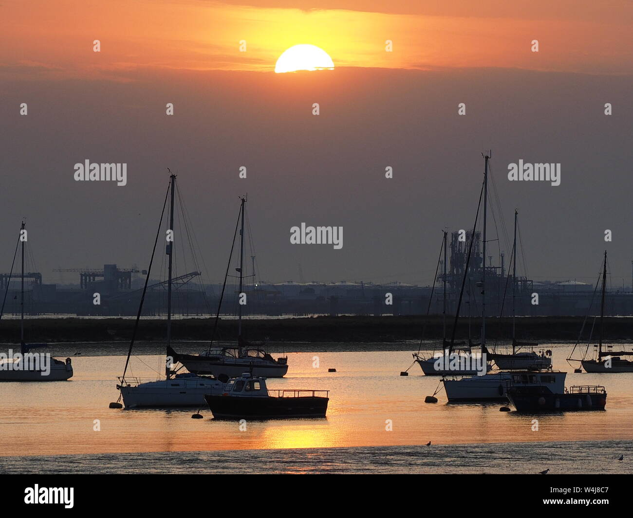 Queenborough, Kent, UK. 23rd July, 2019. UK Weather: this evening's sunset in Queenborough, Kent at the end of a hot and humid day. Credit: James Bell/Alamy Live News Stock Photo
