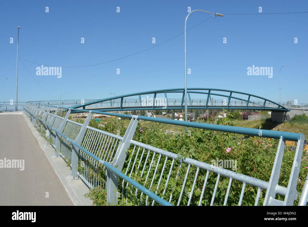 Pedestrian bridge and handrail crossing highway Stock Photo
