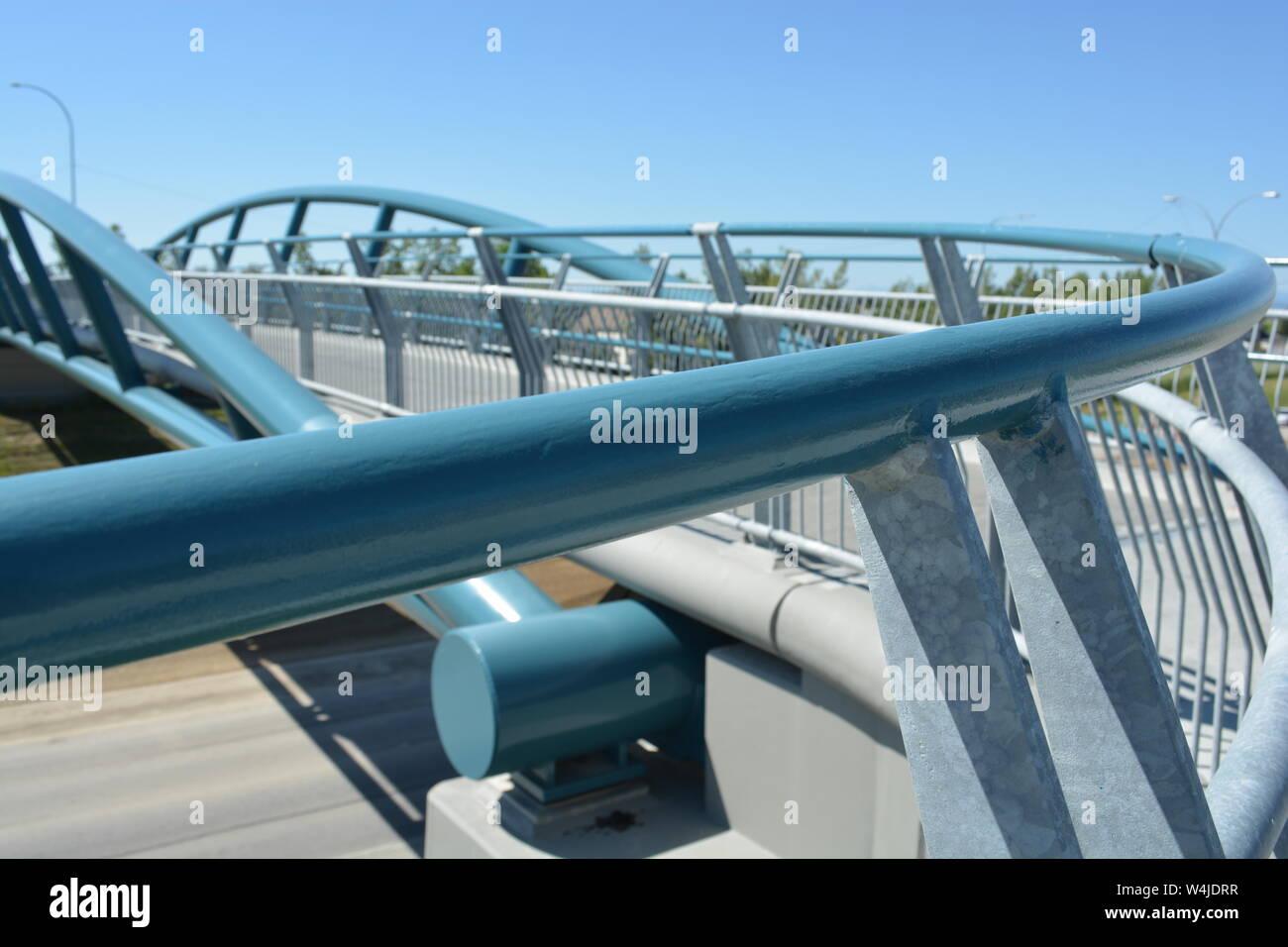 Handrail of pedestrian bridge over highway. Stock Photo