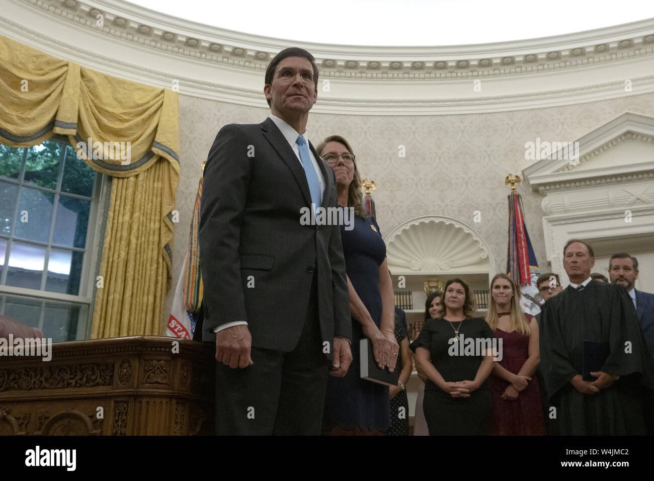 Washington, District of Columbia, USA. 23rd July, 2019. Dr. Mark Esper stands with his wife Leah prior to his swearing in as United States Secretary of Defense in an Oval Office ceremony at the White House in Washington, DC, U.S. on July 23, 2019. Credit: Stefani Reynolds/CNP/ZUMA Wire/Alamy Live News Stock Photo