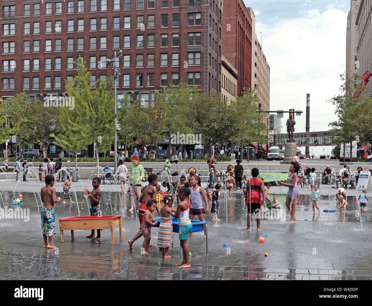Children play in the water fountains of Public Square in downtown Cleveland, Ohio, USA during the summer. Stock Photo