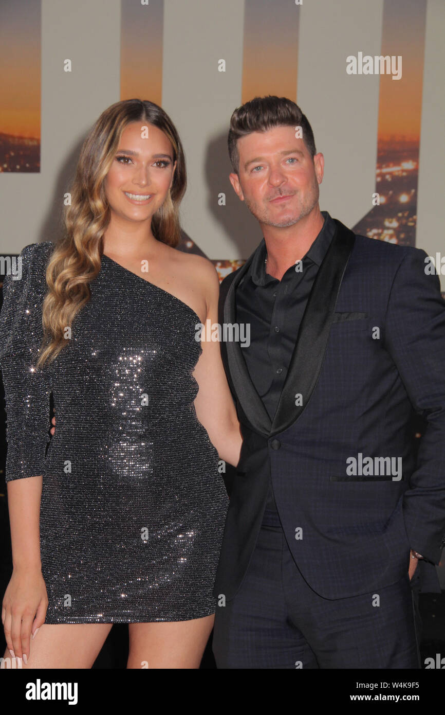 """Los Angeles, USA. 22nd July, 2019. April Love Geary, Robin Thicke 07/22/2019 The Los Angeles Premiere of """"Once Upon A Time In Hollywood"""" held at the TCL Chinese Theatre in Los Angeles, CA Credit: Cronos/Alamy Live News Stock Photo"""