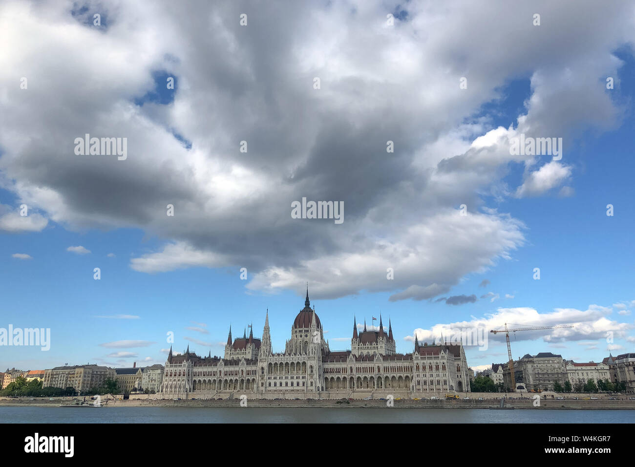 Budapest, Hungary. 23rd July, 2019. Clouds float over the parliament building in downtown Budapest, Hungary, on July 23, 2019. Credit: Attila Volgyi/Xinhua/Alamy Live News Stock Photo