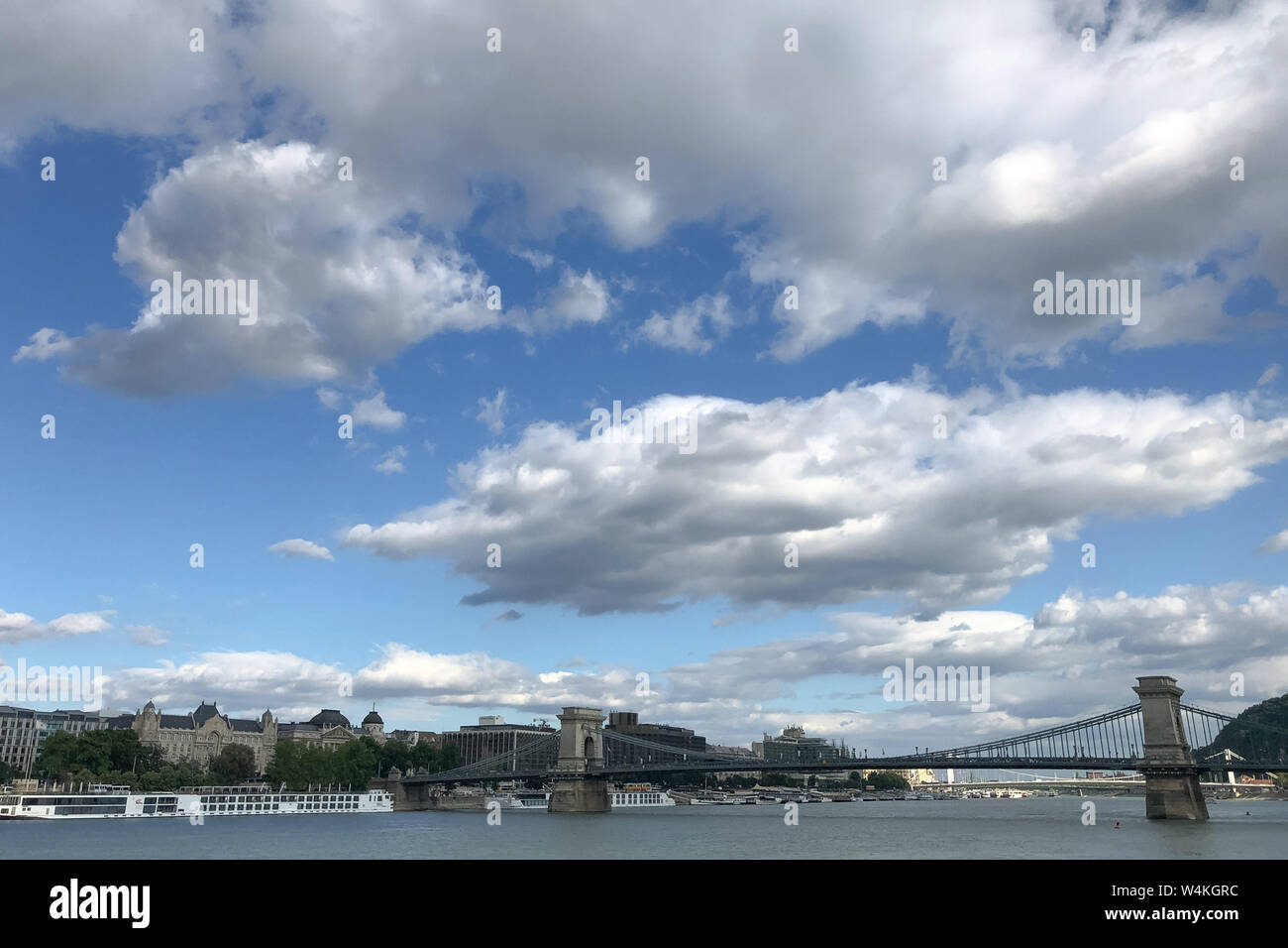 Budapest, Hungary. 23rd July, 2019. Clouds float over the Chain Bridge in downtown Budapest, Hungary, on July 23, 2019. Credit: Attila Volgyi/Xinhua/Alamy Live News Stock Photo