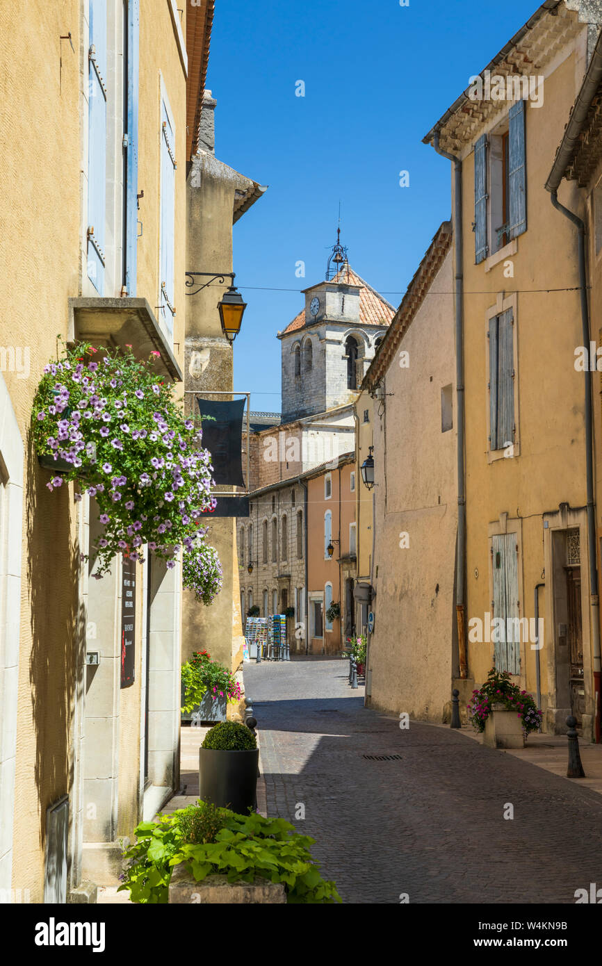 Rue des Ecoles and view of the cathedral, Saint-Paul-Trois-Chateaux, Drome department, Auvergne-Rhone-Alpes, Provence, France, Europe Stock Photo