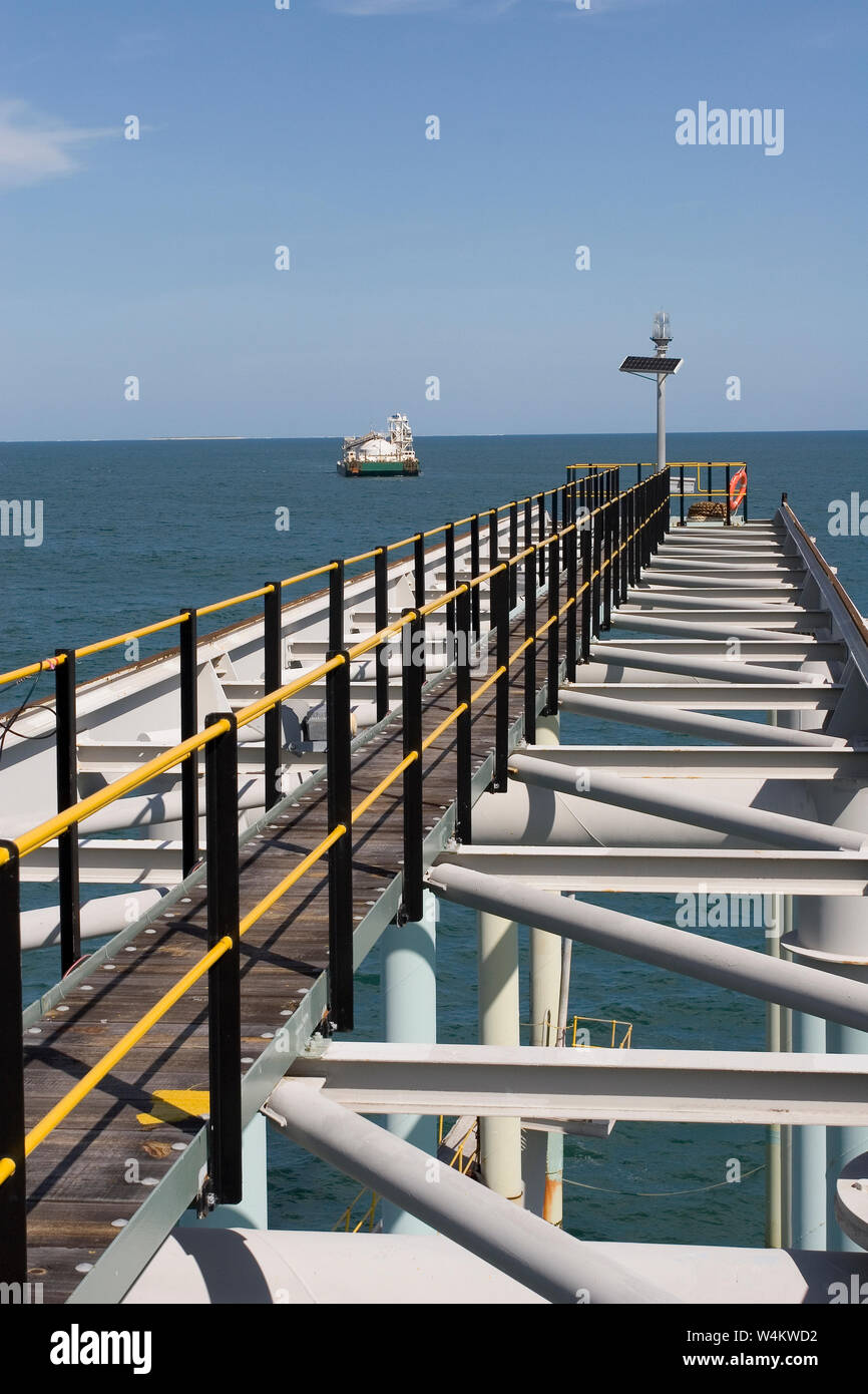 Mining, managing & transporting of titanium mineral sands. Custom built barge arriving back at port jetty after discharging product into OGV at sea. Stock Photo