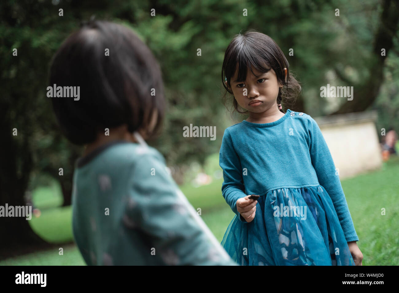 two little girls fighting over toys Stock Photo