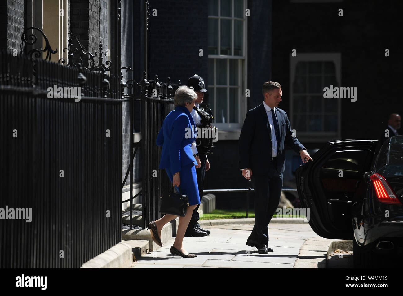 London, UK. 24th July, 2019. British Prime Minister Theresa May leaves 10 Downing Street for her last Prime Minister's Questions at the House of Commons in London, Britain on July 24, 2019. Credit: Han Yan/Xinhua/Alamy Live News Stock Photo
