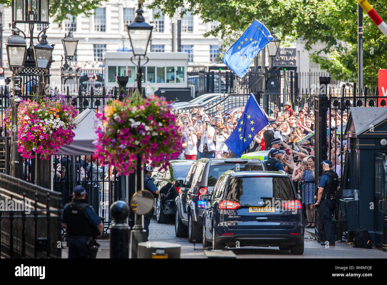 London, UK. 24 July, 2019. Theresa May, accompanied by her husband Philip, leaves Downing Street to proceed to Buckingham Palace to tender her resignation to the Queen. Credit: Mark Kerrison/Alamy Live News Stock Photo