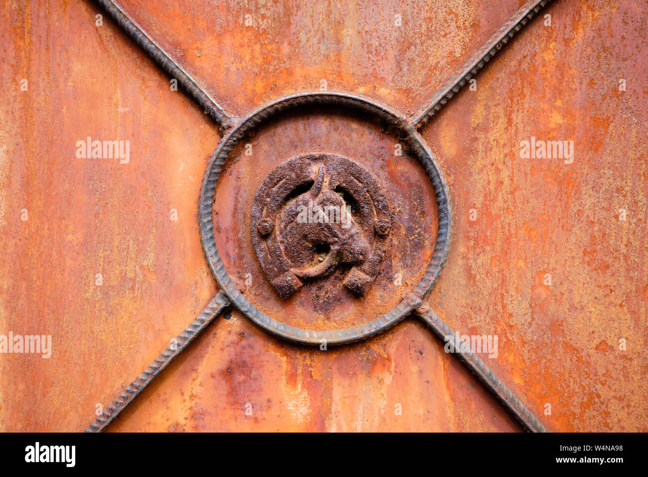 Horse Head Framed In Horseshoe On Close Up Of Old Rusted Abandoned Metal Door Stock Photo Alamy