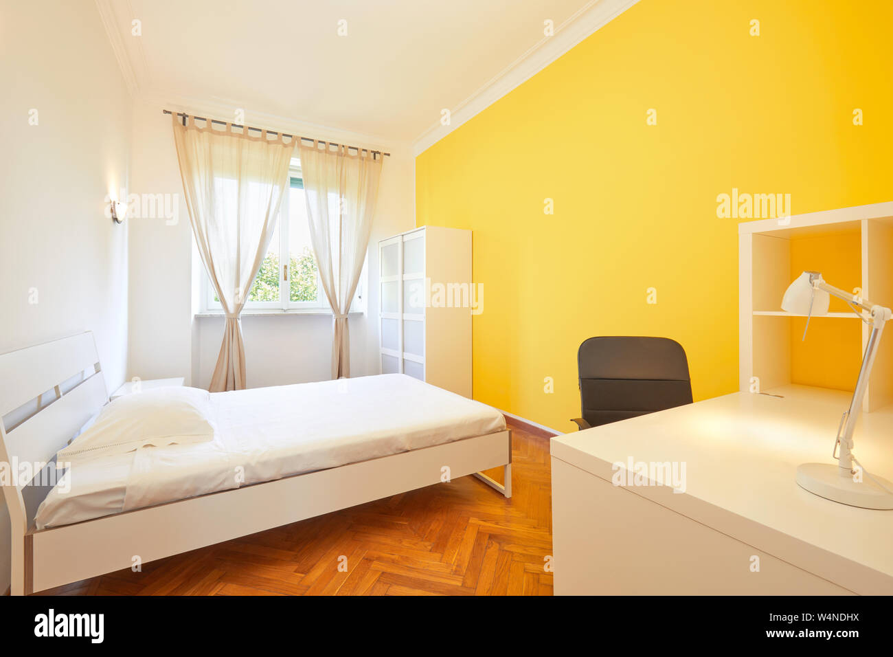 Bedroom for rent in renovated apartment with yellow wall and ...