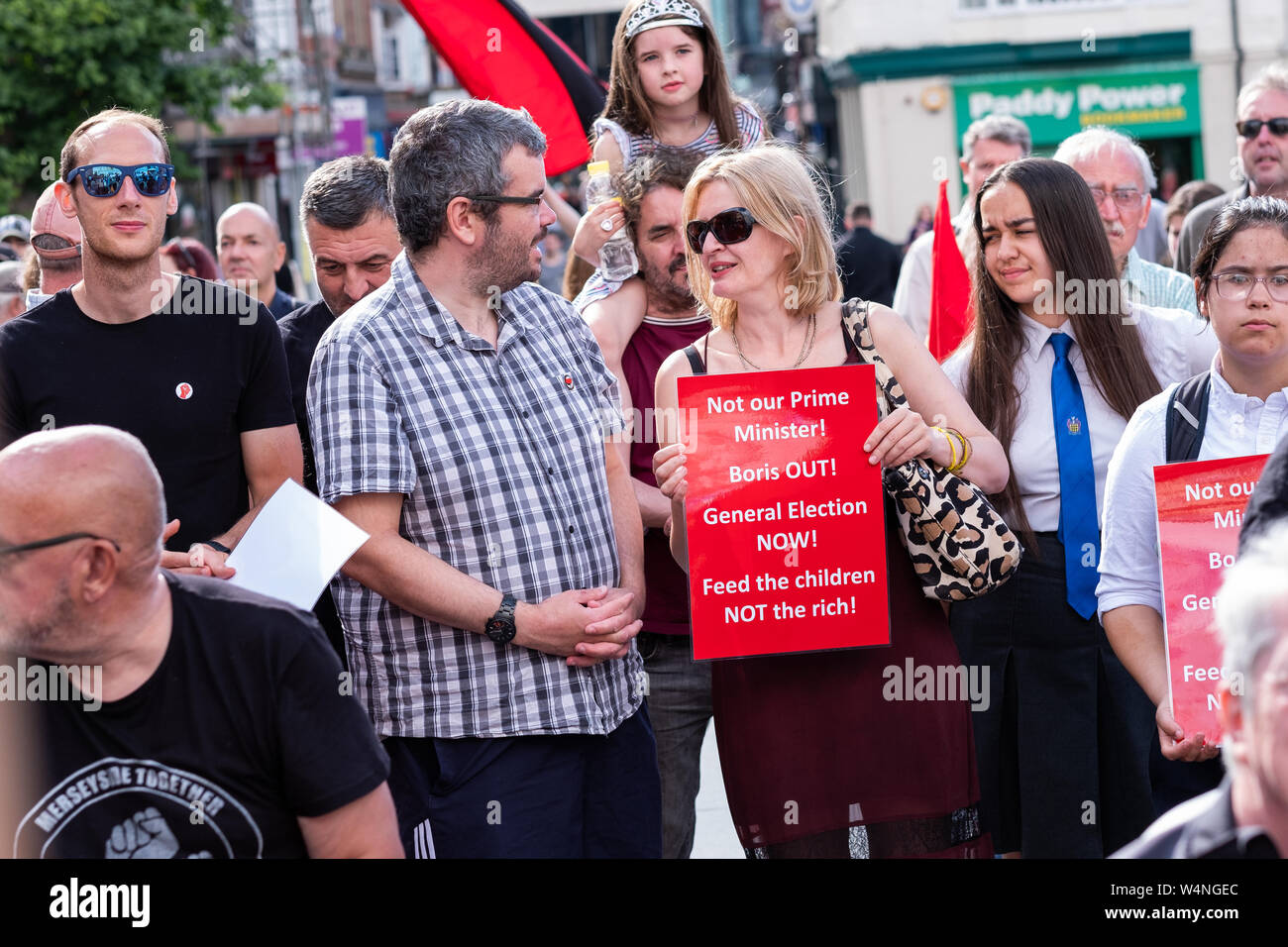 Liverpool, UK. July 24, 2019. Following today's proceedings in London where Boris Johnson took over from Theresa May as the Prime Minister of the United Kingdom, a rally was held in Williamson Square in Liverpool, north west England, against Boris Johnson becoming Prime Minster. Around 100 people attended, some holding banners and placards referring to the new Prime Minster, whilst some participants made speeches. Credit: Christopher Middleton/Alamy Live News Stock Photo