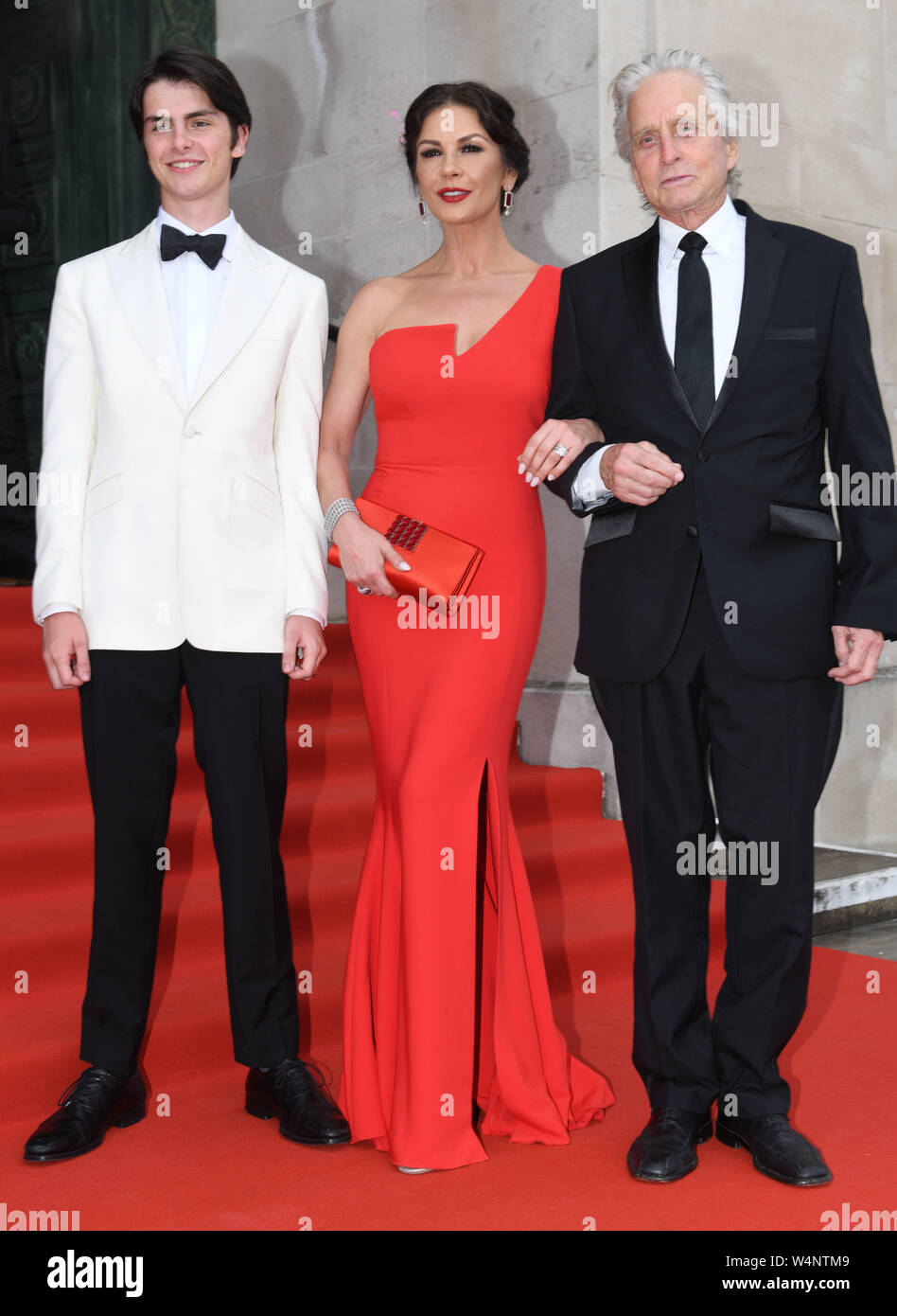 Swansea, Wales, UK. 24th July 2019 Pictured is Welsh actress, Catherine Zeta-Jones with husband Michael Douglas and their son Dylan arriving for a gala dinner at Swansea's Guildhall, to celebrate her  freedom of the city, which she received in a ceremony earlier in the day. Credit : Robert Melen/Alamy Live News. Stock Photo