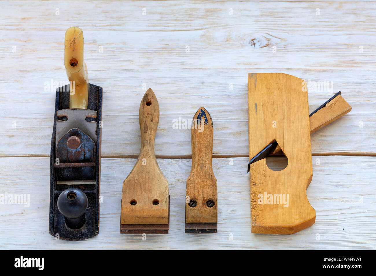 Old Carpentry Hand Tools Planers And Cycles Lie On A White Wooden Table Stock Photo Alamy
