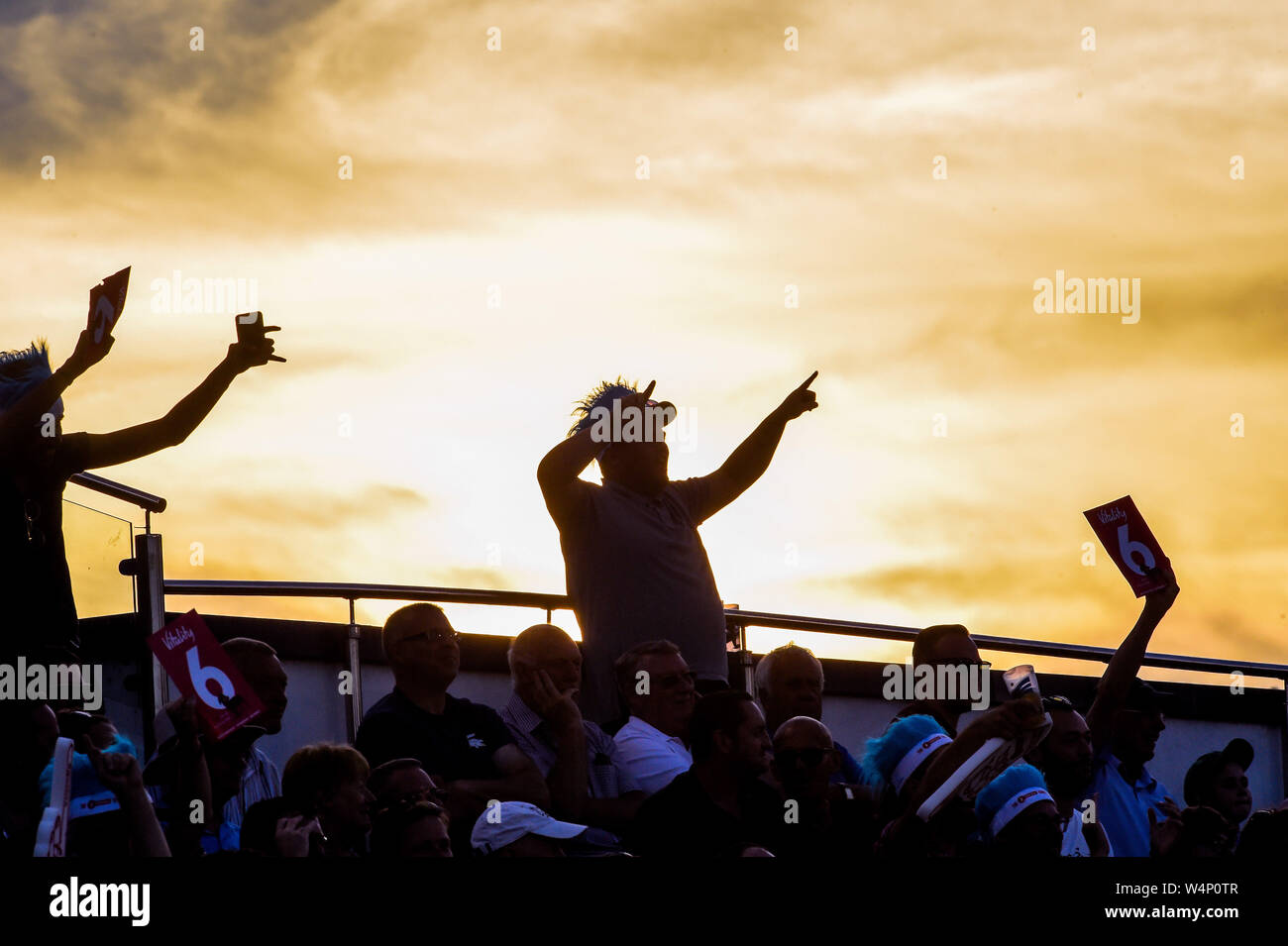 Hove Sussex UK 24th July 2019 - Fans enjoy the evening sunshine during the Vitality Blast South Group Match between Sussex Sharks and Hampshire at the 1st Central County Ground in Hove  . Credit : Simon Dack / Alamy Live News Stock Photo