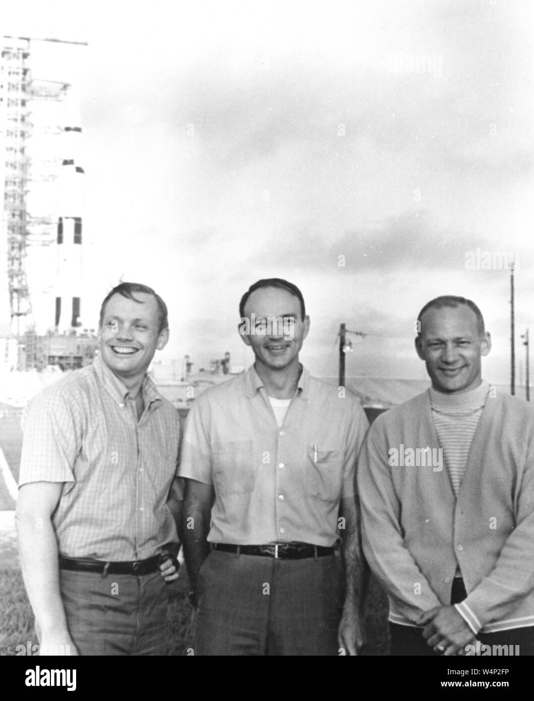 NASA's Apollo 11 flight crew, Neil A Armstrong, Michael Collins, and Buzz Aldrin, stand near the Apollo/Saturn V at Kennedy Space Center in Florida, July 16, 1969. Image courtesy National Aeronautics and Space Administration (NASA). () Stock Photo