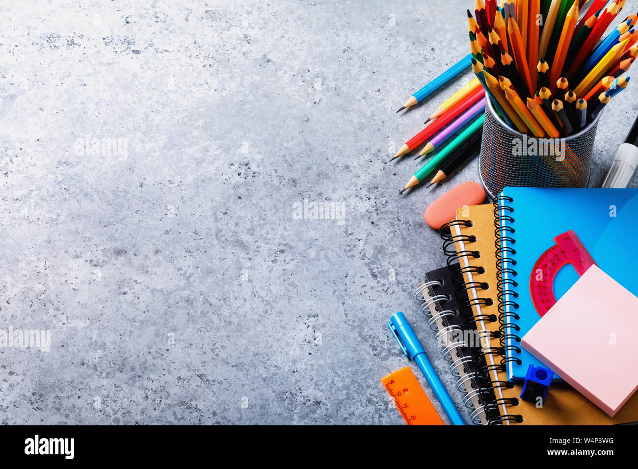 Back to school: various accessories on the table with copy space. Top view on pencils, notebooks and rulers Stock Photo