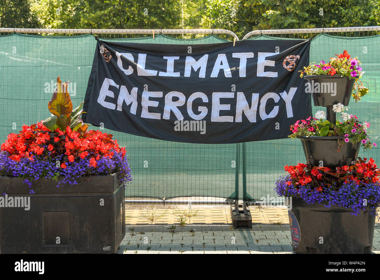 """CARDIFF, WALES - JULY 2019: """"Climate Emergency"""" banner on a fence in Cardiff as part of the climate change protest by Extinction Rebellion Stock Photo"""