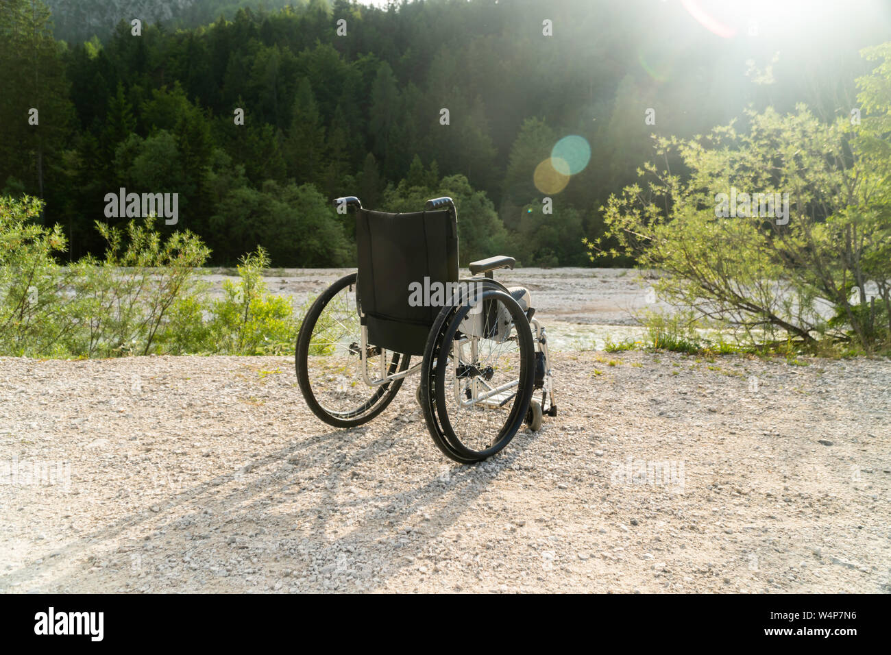 Empty wheelchair parked in park, health care concept Stock Photo